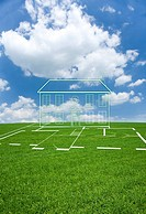 Cut out house in grass field