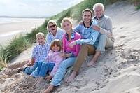 Portrait of multi_generation family sitting on beach