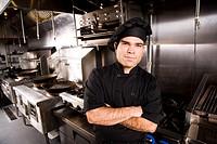 Portrait of Cuban chef standing in restaurant kitchen