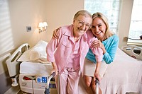 Portrait of adult mother and daughter in hospital room