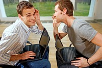 Two men with laptops