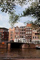 Tall gabled buildings, bridge and canal, Amsterdam, Holland, Netherlands, Europe