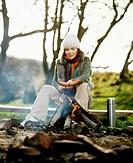 Woman at the bonfire