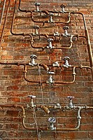Old valves and pipes, Fabra i Coats factory, Barcelona, Catalonia, Spain.