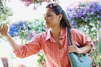 Mixed race woman shopping in garden nursery