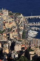 Monte Carlo district with the road leading up to the Casino, the start of the Formula 1 race track, top left, the Casino, and to the right the port of...