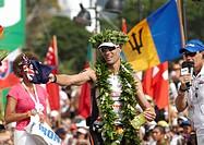 The Australian Craig Alexander crossing the finish line of the Ironman Triathlon World Championship as the winner in 8:20:21 hours, Kailua-Kona, Hawai...