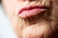 Lips of woman, wrinkled face  Kiss  Color