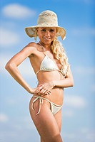 Young woman wearing bathsuit and hat