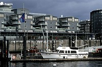 White boat in Niederhafen, in front of the headquarters of Gruner & Jahr Publishing, Baumwall, Hanseatic City of Hamburg, Germany, Europe