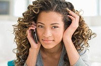 Portrait of a girl talking on a mobile phone