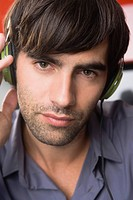 Portrait of a man listening to headphones