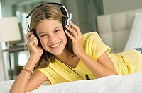 Portrait of a girl listening to music with headphones