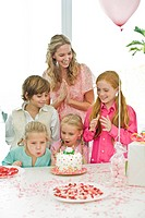 Girl celebrating her birthday with her mother and friends
