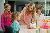 Woman celebrating her daughter´s birthday
