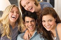 Portrait of four friends smiling