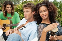Friends playing musical instruments