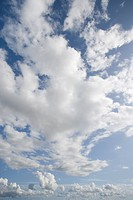 Clouds in sunny blue sky