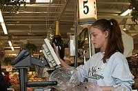 St  Clair Shores, Michigan - Anisa Bakiu, 18, works as a cashier at the Nino Salvaggio International Marketplace