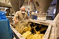 Chelsea, Michigan - A worker at Chelsea Milling Company monitors a mixing machine  The company makes a variety of prepared baking mix products under t...