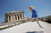 Woman jump in front the Parthenon, Acropolis, Athens, Greece