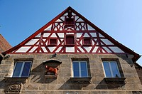 Red ox figure mounted on the wall of an old butchery, 1782, with half-timbered gables, Lauf an der Pegnitz, Middle Franconia, Bavaria, Germany, Europe
