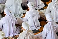 Nuns, ceremonial midday prayer in the Cao Dai temple, Tay Ninh, Vietnam, Asia