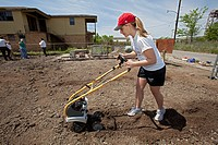 Volunteer helps transforming a vacant lot in the lower ninth ward that was flooded by Hurricane Katrina into a community garden, New Orleans, Louisian...