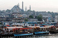 Panorama of the city with Sueleymaniye Mosque and boats, evening mood, Golden Horn, Istanbul, Turkey