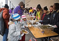 Washington, DC - Volunteers serve food to the hungry at an outdoor soup kitchen  The volunteer project was one of many Martin Luther King Day communit...