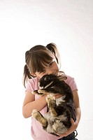 A little girl cuddling with her rabbit