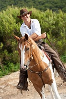 man riding horse smiling