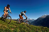 mountain biking pair in Savoy, north Alps mountains, France, Savoie, Tarentaise