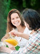 Man and woman having drink in country