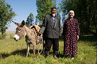kazakhstanian couple with donkey come back from a ride, Kazakhstan