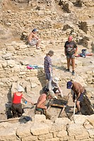 Archaeology students doing excavation work at the old Greek settlement of Tyras, Tira, in front of the walls of the Akkerman fortress, in Bilhorod-Dni...