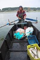Creek fisherman on his way to his nets, Greece