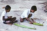 children building a boat, Maldives