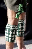 Man wearing so called Wadelwaermer, diamond-patterned woolen accessoire for keeping the calves warm, Bavarian costume, in Seehausen, Bavaria, Germany,...