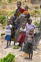 black woman with baby and children, Africa