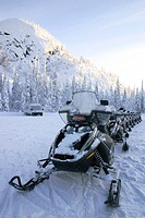 Snowmobiles ready to go in wintry scenery, Finland, Lapland
