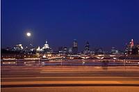 Skyline at dusk with moon with Waterloo Bridge