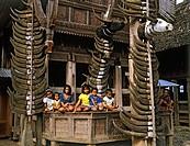 Children in front of a Toraja house, Toraja village, Sulawesi, Indonesia, Asia