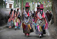 Buddhist Ladakhi women wearing traditional dress and hats with long platted hair