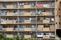 Typical use of balconies as roofed clothes dryers, storage space, with satellite dish, Iwakura near Kyoto, Japan, Asia