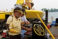 Detroit, Michigan - The crew of Leland Racing´s Happy Go Lucky unlimited hydroplane searches for parts for a repair prior to the running of the Gold C...