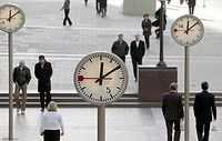 Public place with clocks in Canary Wharf in London, England, Great Britain, Europe