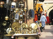 Stall selling bronze items in street