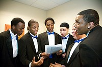 Detroit, Michigan - Young men warm up their voices as the Mosaic Singers prepare for a concert  The Mosaic Singers are part of Mosaic Youth Theatre, w...