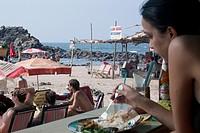 Arpora Beach, Goa, India. Lunch at a restaurant on Arpora Beach with view of beach. Arpora is famous for selling fresh fish such as prawns, tiger praw...